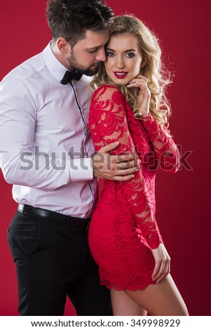 Charming couple on the red background - stock photo