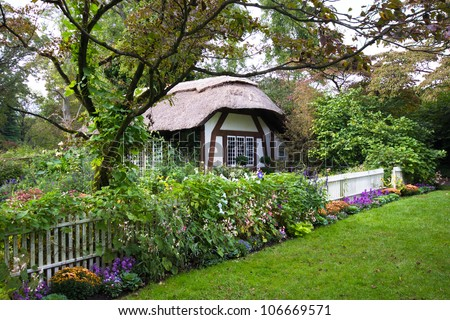 Charming English style cottage in the garden - stock photo