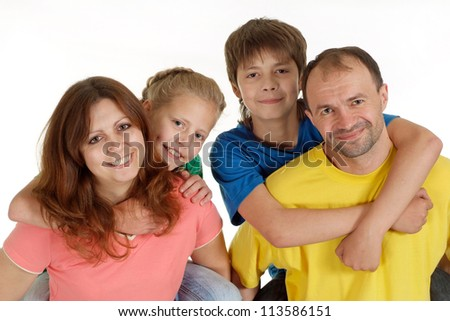 Charming family of four in bright T-shirt on a white background - stock photo