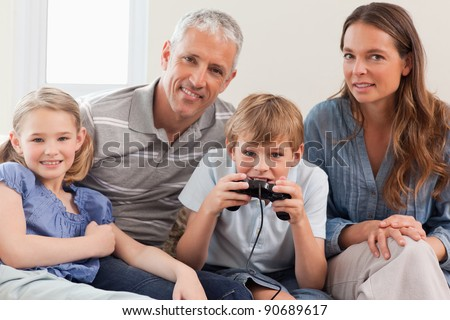 Charming family playing video games in a living room