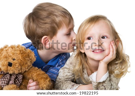 Charming girl and little boy with a teddy bear - stock photo