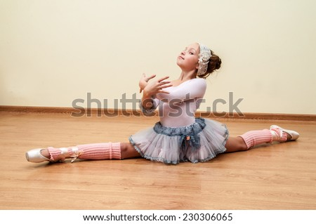 Charming girl dancing in ballet studio - stock photo