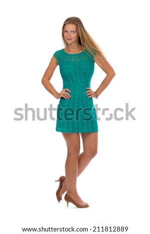 Charming girl in a dress full length on white isolate.