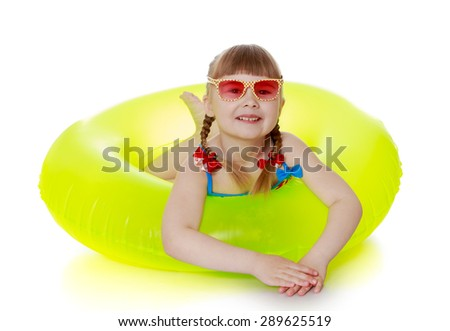 Charming girl in a swimsuit, sunglasses and yellow lifebuoy - isolated on white background - stock photo