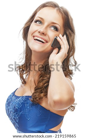 Charming girl in blue dress speaks by phone, isolated on white background. - stock photo