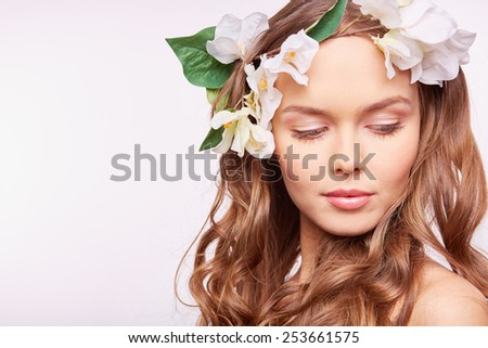 Charming girl in floral wreath - stock photo