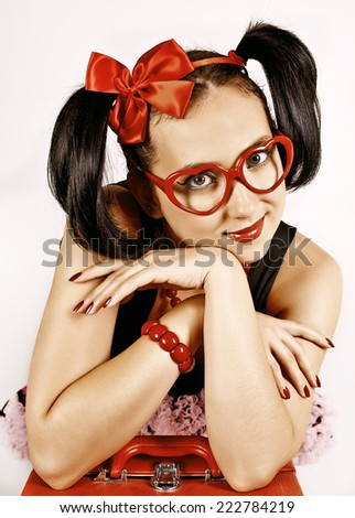 Charming girl in glasses with red case