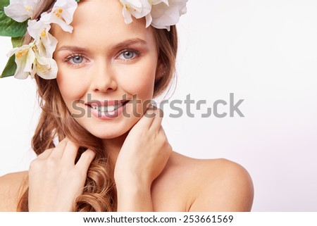 Charming girl looking at camera with smile - stock photo