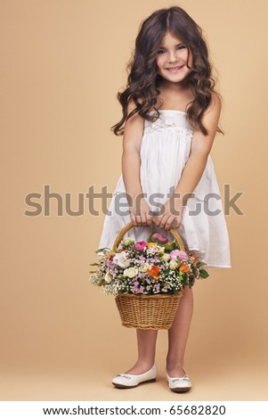 Charming girl with flower basket. Space for text. - stock photo