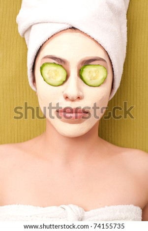 Charming girl with mask on her face - stock photo