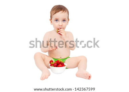 Charming kid eats ripe strawberries isolated on white background - stock photo