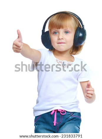 Charming little girl in headphones.Isolated on white background. - stock photo