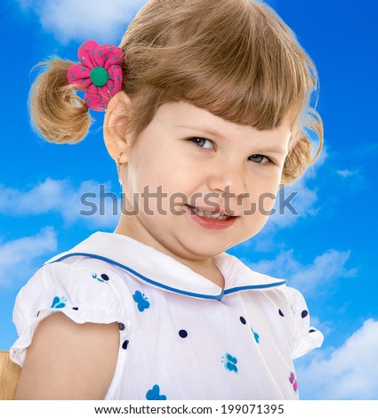 charming little girl in white dress smiling cheerfully. - stock photo