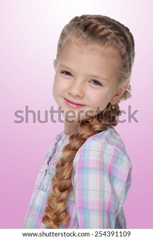 Charming little girl with beautiful long braid on white background