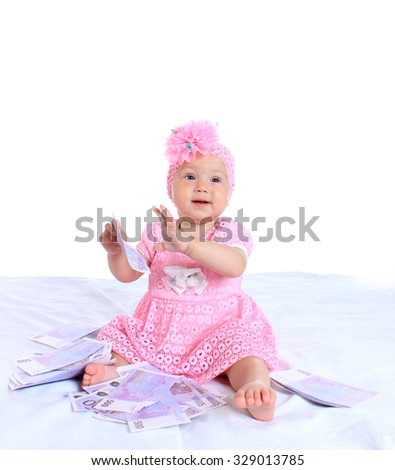 charming little girl  with euro on a blanket on an isolated white background