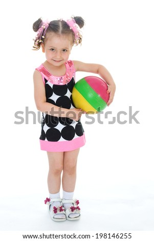 Charming little girl with the ball is on a white background - stock photo