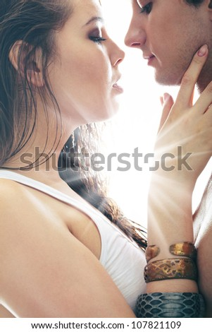 Charming lovers being about to kiss - stock photo