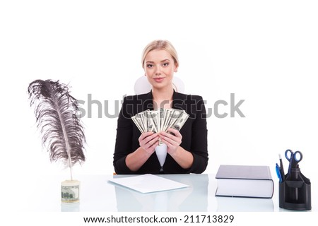 Charming mature businesswoman sitting at table. successful businesswoman holding money on white background - stock photo