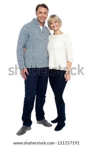 Charming middle aged dressed in casual winter wear isolated against white. - stock photo