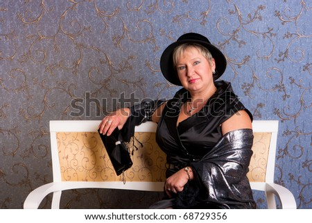 charming middle aged  woman  in a hat