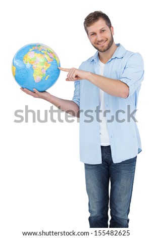 Charming model holding a globe on white background