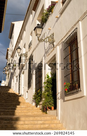 Charming narrow old town street in Altea, Costa Blanca, Spain - stock photo