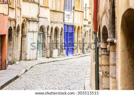 Charming, narrow street in Lyon, France . - stock photo