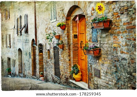 charming old streets of medieval towns of Tuscany. Artistic picture - stock photo