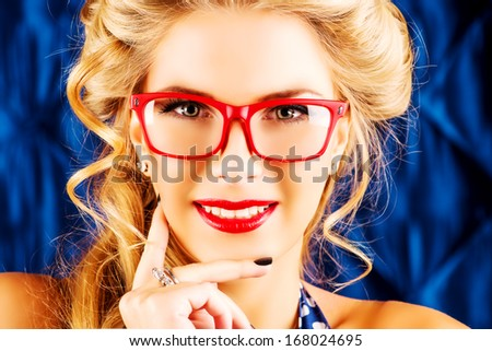Charming pin-up woman with retro hairstyle and make-up. - stock photo