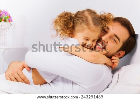 Charming portrait of happy father and  daughter - stock photo