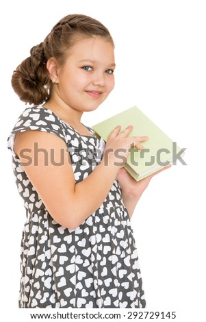 Charming schoolgirl dreaming in a gray silk dress covered hands a book to read , close-up - isolated on white background - stock photo
