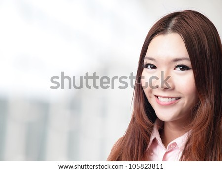 charming smile face close up of a beautiful business woman at office, model is a asian beauty - stock photo