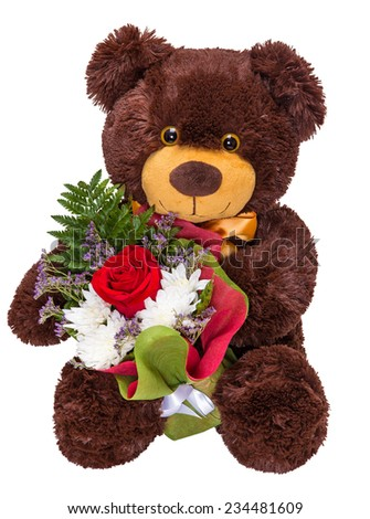 Charming smiling teddy bear holding a bouquet of fresh flowers in paws isolated on white background - stock photo