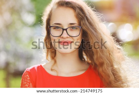 Charming smiling woman in glasses - stock photo