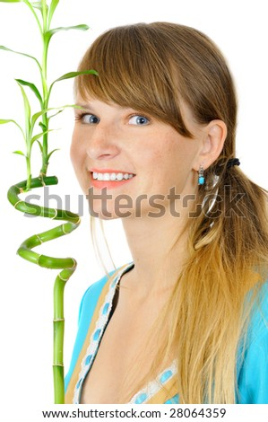 Charming smiling young girl with a bamboo, isolated on white - stock photo