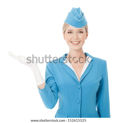 Charming Stewardess Dressed In Blue Uniform Holding In Hand On White Background - stock photo