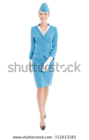 Charming Stewardess Dressed In Blue Uniform On White Background - stock photo