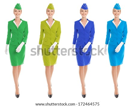 Charming Stewardess Dressed In Uniform With Color Variants. Isolated On White Background. - stock photo