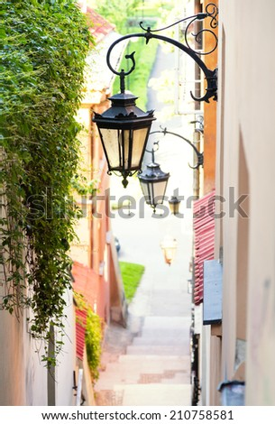 Charming stone steps in Warsaw, Poland with antique street lights - stock photo