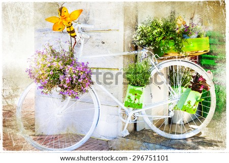 charming street decoration with bike and flowers, artistic pictu - stock photo