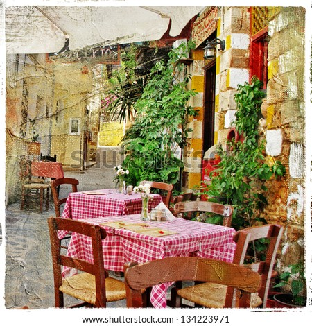 charming streets of greek islands with traditional tavernas - stock photo