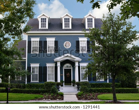 charming, two-story colonial home in small town America - stock photo
