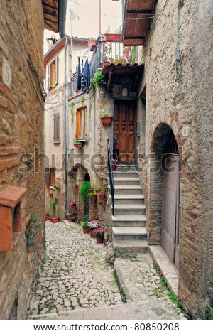 Charming village, with narrow streets, between quaint houses - stock photo