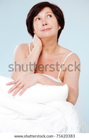 Charming woman after sleeping - stock photo