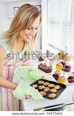 Charming woman baking in the kitchen at home - stock photo