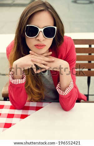 Charming woman in an outdoor restaurant  - stock photo