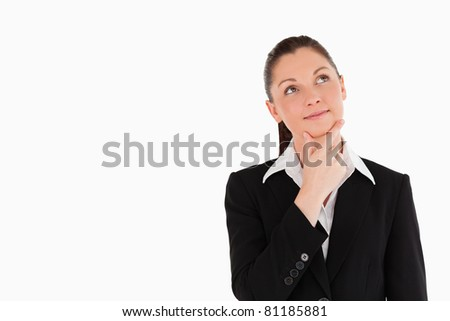 Charming woman in suit posing while standing against a white background - stock photo