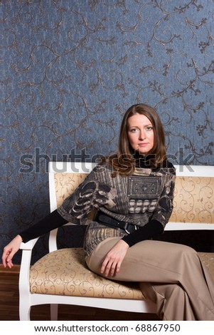 charming  woman on a sofa