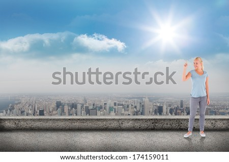 Charming woman pointing against balcony overlooking city