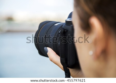 Charming woman using a camera